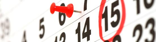 kalenderdatum, nål och inringad siffra