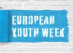 Tegelvägg med blå ruta där det står European Youth Week. Illustration: MUCF