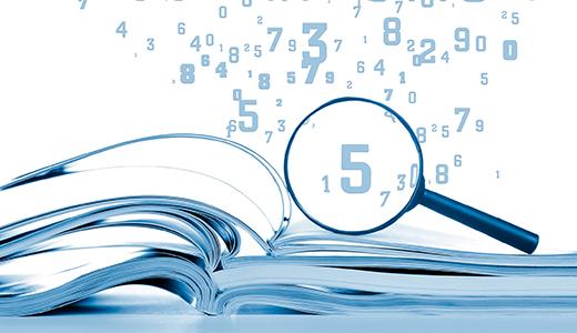 Temabild: förstoringsglas som tittar på siffror över en rapport.