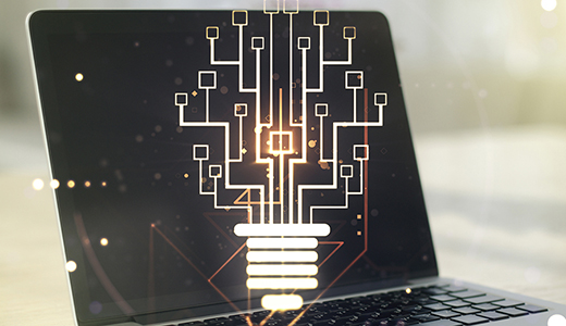 Temabild med en dator som har en stiliserad glödlampa på skärmen.
