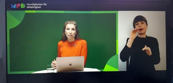 Beata Wickström och en teckenspråkstolk