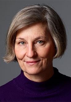 Foto av Gertrud Åström, en kvinna i pagefrisyr.